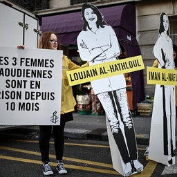 Cartoon cutouts of women incarcerated in Saudi Arabia, outside the Saudi embassy in Paris, France on March 8, 2019 (Photo via Getty Images)