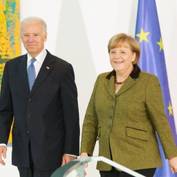 Then US Vice President Joe Biden and German Chancellor Angela Merkel speak to the media prior to talks at the Chancellery on Feb. 1, 2013 in Berlin, Germany. (Photo via Getty Images)