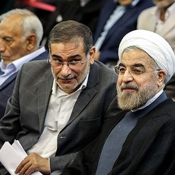 Hassan Rouhani and Ali Shamkhani at a summit for Iranian veterans of the 1980-88 Iran-Iraq war. Tehran, Iran. July 16, 2013. (Photo by Hamed Malekpour via Tasnim News Agency)