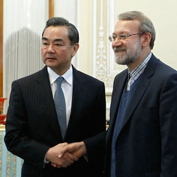 Former parliament speaker Ali Larijani (right) meets Chinese Foreign Minister Wang Yi in Tehran on Jan.21, 2015. (Photo by Majid Asgaripour via Mehr News Agency)