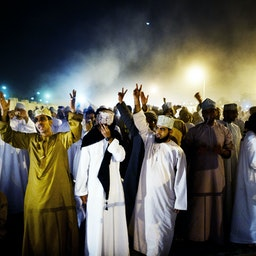 Anti-government protesters gather near Muscat, Oman on March 7, 2011 (Photo via Getty Images)