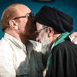Parliament Speaker Mohammad Baqer Qalibaf kisses Chief Justice Ebrahim Raisi's forehead at an electoral summit in Tehran, Iran on May 17, 2017. (Photo by Mahmoud Hosseini via Tasnim News Agency)