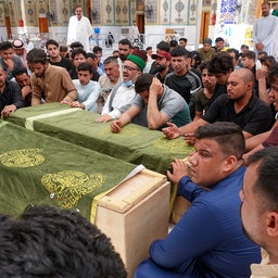 Iraqis mourn loved ones killed in a fire at Baghdad's Ibn Al-Khatib hospital. Najaf, Iraq. April 25, 2021. (Photo via Getty Images)