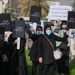 Women protest against gender-based violence in Kuwait City on Apr. 22, 2021. (Photo via Getty Images)