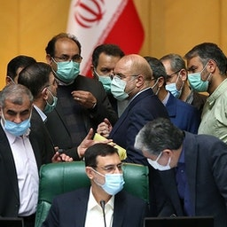 A group of Iranian lawmakers talking to each other in a parliamentary session. Tehran, Iran. March. 16, 2021.  (Photo by Seyyed Mahmoud Hosseini via Tasnim News Agency)