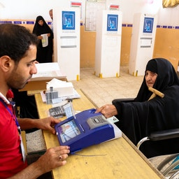 An Iraqi woman has her biometric voting card checked in Najaf, Iraq. May 12, 2018. (Photo via Getty Images)