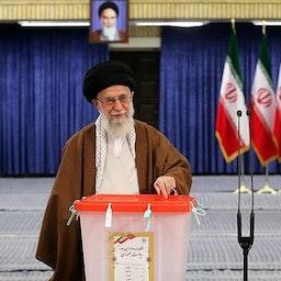 Iran's Supreme Leader Ayatollah Ali Khamenei casts his vote into a ballot box during presidential elections in Tehran, Iran on May 19, 2017. (Photo by Mahmood Hosseini via Tasnim News Agency)