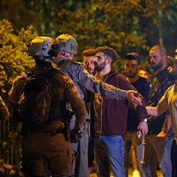 Palestinian protesters confront Israeli police in Sheikh Jarrah in East Jerusalem on May 7, 2021. (Photo via Getty Images)