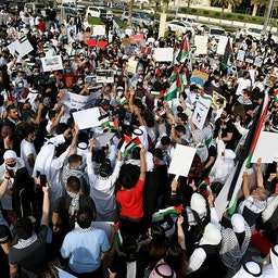 Kuwaitis hold banners and Palestine flags during a demonstration against Israel in Kuwait City on May 11, 2021. (Photo via Getty Images)