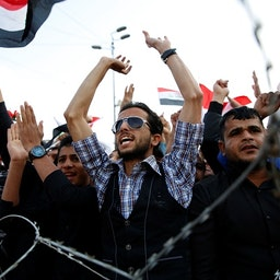 Supporters of Iraqi Shiite cleric Muqtada Al-Sadr chant slogans in Baghdad on March 24, 2017. (Photo via Getty Images)