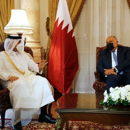 Egyptian Foreign Minister Sameh Shoukry (R) meets with Qatar's Deputy Prime Minister and Foreign Minister Mohammed bin Abdulrahman bin Jassim Al-Thani in Cairo, on May 25, 2021. (Photo via Getty Images)