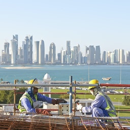 Laborers work on a construction site in Doha, Qatar. March 26, 2013. (Photo via Getty Images)
