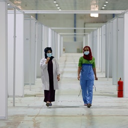 Health care workers at a temporary Covid-19 hospital in Baghdad. July 18, 2020. (Photo via Getty Images)