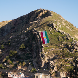 A Kurdish flag is placed on a mountain in Duhok governorate, Iraq on March 18, 2021. (Photo via Getty Images).