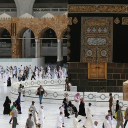 Pilgrims circumambulate around the Kaaba, Islam's holiest shrine, in the holy city of Mecca on Aug. 2, 2020. (Photo via Getty Images)