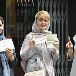 Iranian women pose for a photo after casting their votes in presidential elections in Rasht, Iran on May 20, 2017. (Photo by Mohammad Ranjbar via Tasnim News Agency)