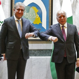Pakistani Foreign Minister Shah Mehmood Qureshi (L) poses for a photo with his Iraqi counterpart Fuad Hussein in Baghdad, Iraq on May 29, 2021. (Photo via Getty images)