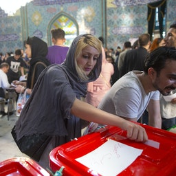 Iranian voters cast their ballots for the presidential and municipal council elections on May 19, 2017 in the city of Qom. (Photo via Getty Images)