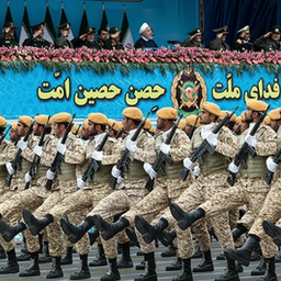 Iranian President Hassan Rouhani (top center) reviews army troops marching during the National Army Day parade in Tehran, Iran on Apr. 18, 2019. (Photo by Hossein Zohrevand via Tasnim News Agency)