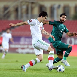 Iran's Sardar Azmoun in action against Iraq's Ahmad Ibrahim Khalaf during a FIFA World Cup qualifier in Bahrain on June 15, 2021. (Photo via Getty Images)