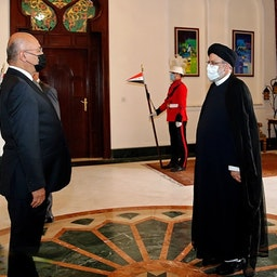Iran's then chief justice Ebrahim Raisi (R) meets Iraqi President Barham Salih in Baghdad on Feb. 10, 2021. (Photo via Mizan News Agency)