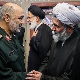 IRGC Intelligence Organization head Hossein Taeb (R) greets IRGC chief commander Hossein Salami (L) at a function in Tehran on June 24, 2018. (Photo by Hamed Malekpour via Tasnim News Agency)