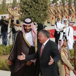Jordan's King Abdullah II speaks with Saudi Arabia's then deputy Crown Prince Mohammed bin Salman in Amman on Aug. 4, 2015. (Photo via Getty Images)