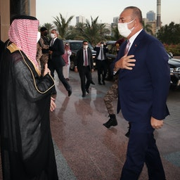 Saudi Foreign Minister Faisal bin Farhan Al Saud (L) welcomes his Turkish counterpart Mevlüt Çavuşoğlu in Saudi Arabia on May 11, 2021. (Photo via Getty Images)