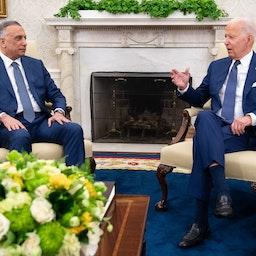 US President Joe Biden speaks with Iraqi Prime Minister Mustafa Al-Kadhimi in the White House on July 26, 2021. (Photo via Getty Images)