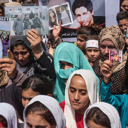 Yazidi women hold pictures of their loved ones killed by the Islamic State group in Sinjar, Iraq on Aug. 3, 2014. (Photo via Getty Images)