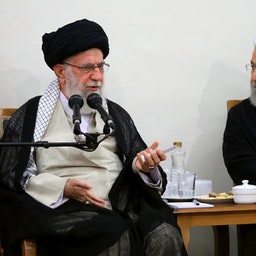 Iran's Supreme Leader Ayatollah Ali Khamenei and then President Hassan Rouhani in a meeting in Tehran on Aug. 21, 2019 (Photo via Iran's supreme leader's website)