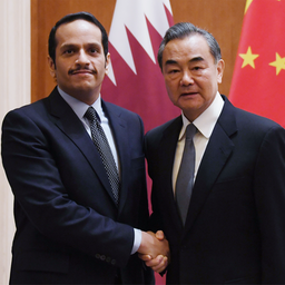 Qatari Deputy Prime Minister and Foreign Minister Sheikh Mohammed bin Abdulrahman Al Thani (L) is greeted by his Chinese counterpart Wang Yi in Beijing on Dec. 12, 2018. (Photo via Getty Images).