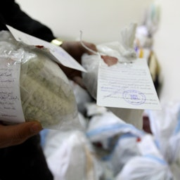 Police show seized drugs and Captagon pills in Damascus on Jan. 4, 2016. (Photo via Getty Images)