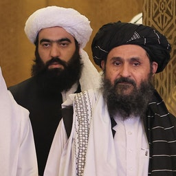 Head of Afghanistan's High Council for National Reconciliation Abdullah Abdullah (L) and Taliban political office head Mullah Abdul Ghani Baradar in Doha, Qatar on July 18, 2021. (Photo via Getty Images)