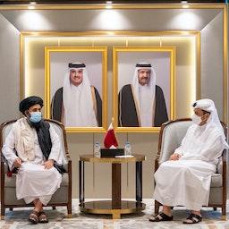 Qatari Deputy Premier and Foreign Minister Sheikh Mohammed bin Abdulrahman Al Thani (R) meets with the head of the Taliban's political in Qatar Abdul Ghani Baradar (L) in Doha on Aug. 17, 2021. (Photo via Getty Images)