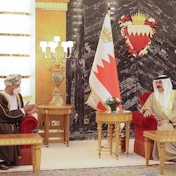 Omani Foreign Minister Sayyid Badr Al-Busaidi (L) meets with Bahrain's King Hamad bin Isa Al Khalifa in Manama on Aug. 29, 2021. (Handout photo via Twitter)