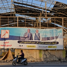 An electoral banner for a candidate ahead of the upcoming parliamentary elections in Mosul, Iraq on Sept. 5, 2021. (Photo via Getty Images)