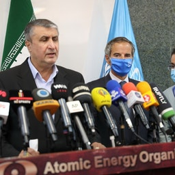 IAEA Director General Rafael Grossi and AEOI chief Mohammad Eslami at a joint press conference in Tehran on Sept. 12, 2021. (Photo via Getty Images)