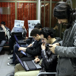 Iranian investors watch the prices of shares at the Tehran Stock Exchange on Jan. 4, 2014. (Photo via Getty Images)