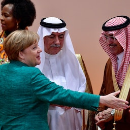 German Chancellor Angela Merkel chats with members of the Saudi delegation at the G20 economic summit in Hamburg, Germany on July 8, 2017. (Photo via Getty Images)