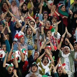 Female football fans show their support during the Iran vs. Cambodia match at Azadi Stadium in Tehran, Iran on Oct. 10, 2019. (Photo via Getty Images)