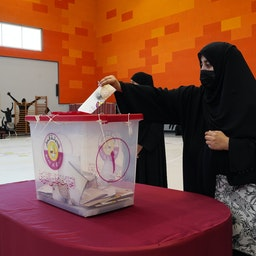 Qataris cast their ballots during the country's first legislative elections in Doha on Oct. 2, 2021. (Photo via Getty Images)