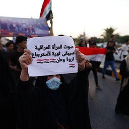 Hundreds of Iraqis protest demanding justice for demonstrators killed during the 2019 revolt at the Tahrir Square in Najaf, Iraq on Oct. 1, 2021. (Photo via Getty Images)