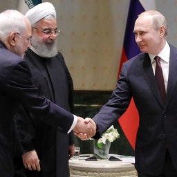 Iran's then Foreign Minister Mohammad Javad Zarif, then President Hassan Rouhani and Russia's President Vladimir Putin (L-R) meet in Ankara, Turkey on Aug. 4, 2018 (Photo via Getty Images)
