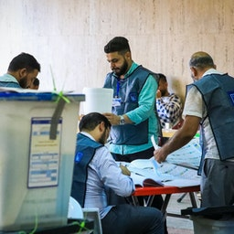 Election commission officials count the votes after the Oct. 10 parliamentary elections in Baghdad, Iraq on Oct. 13, 2021. (Photo via Getty Images)