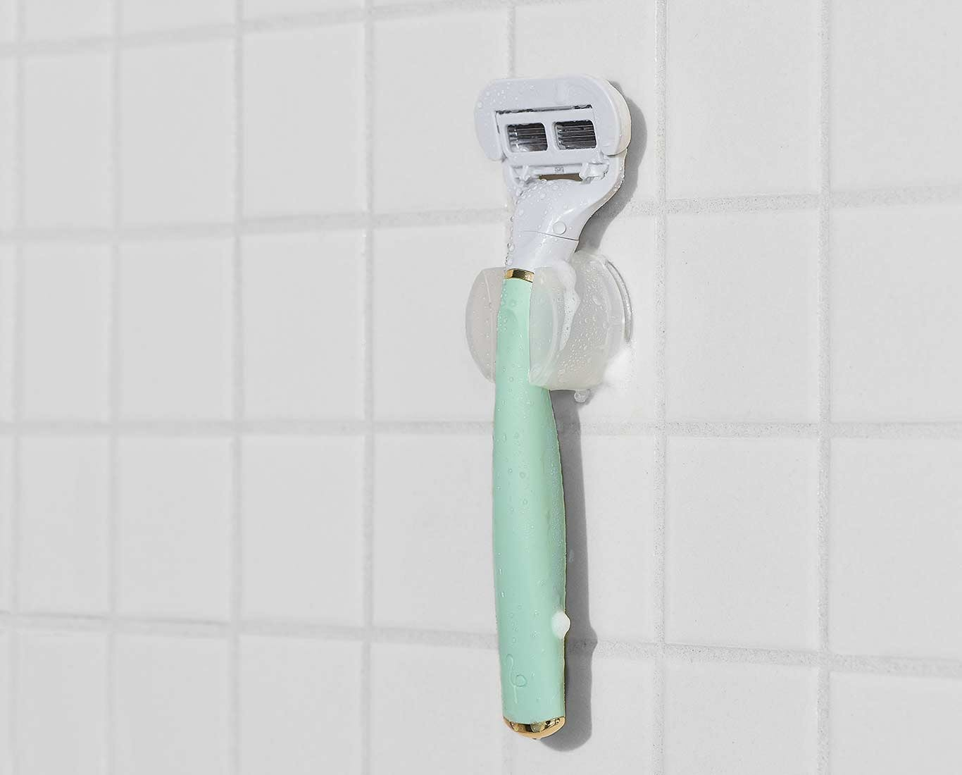 Flamingo mint razor hanging on shower hook