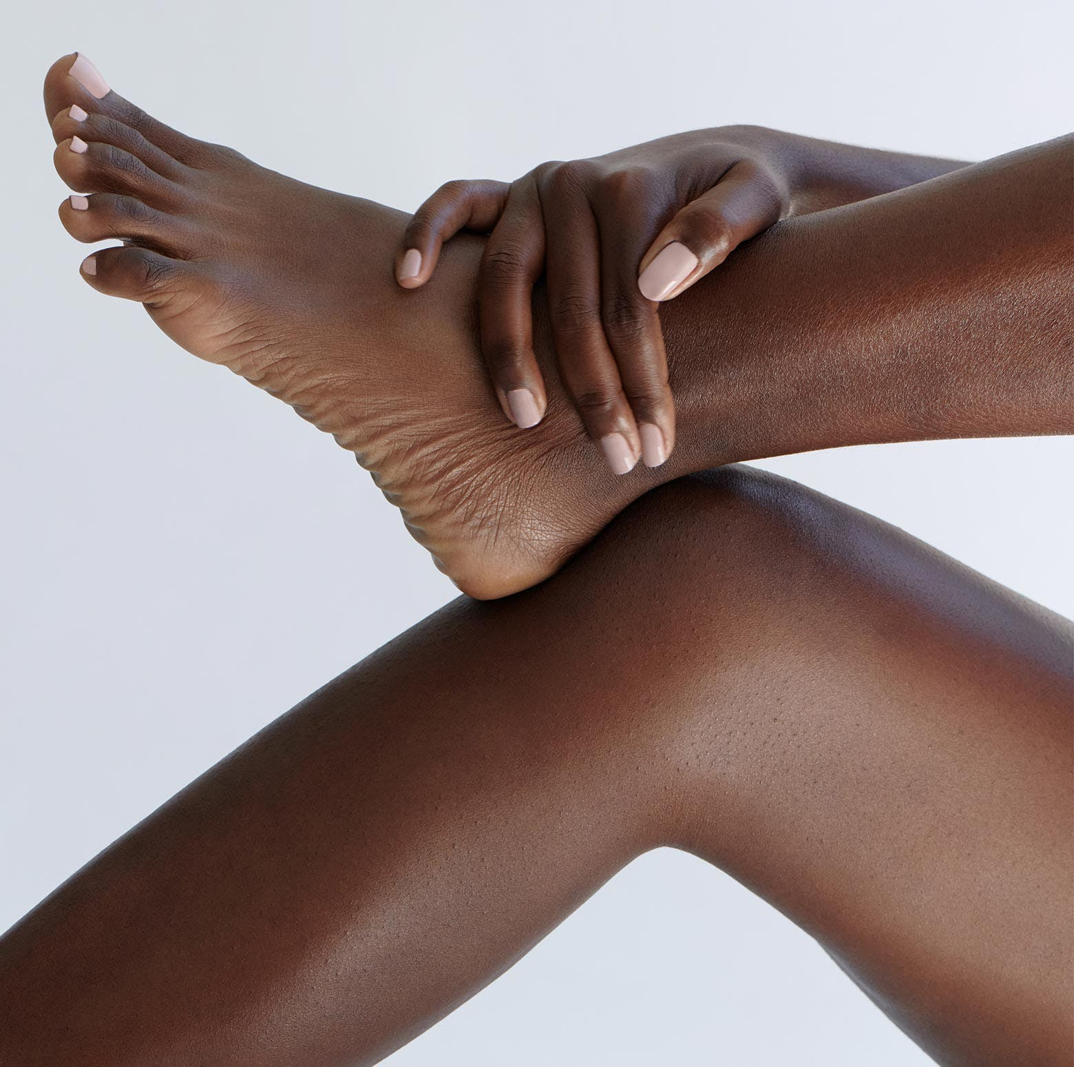 Woman holding ankle