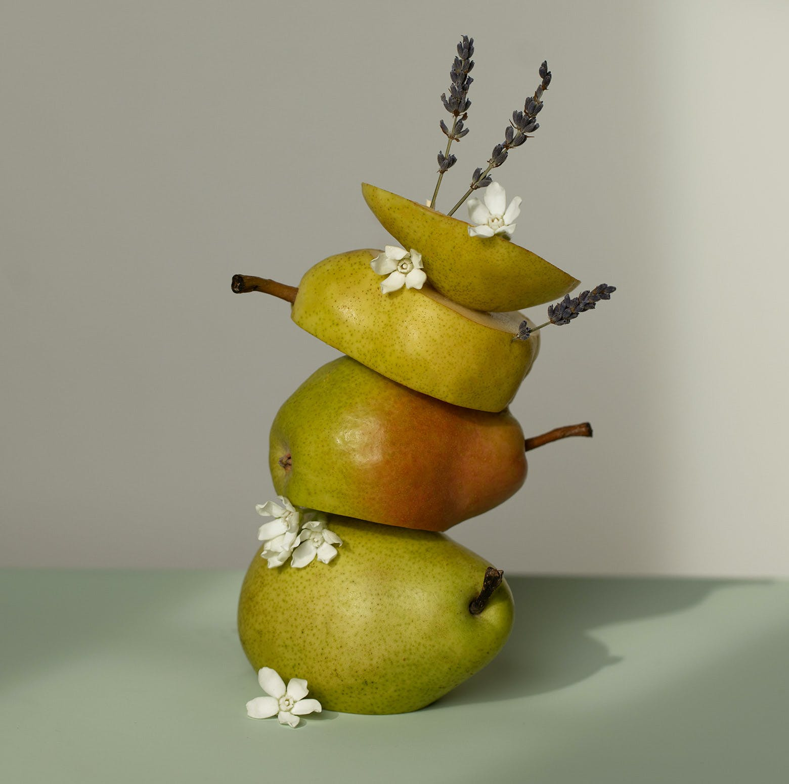 Pears and flowers stacked