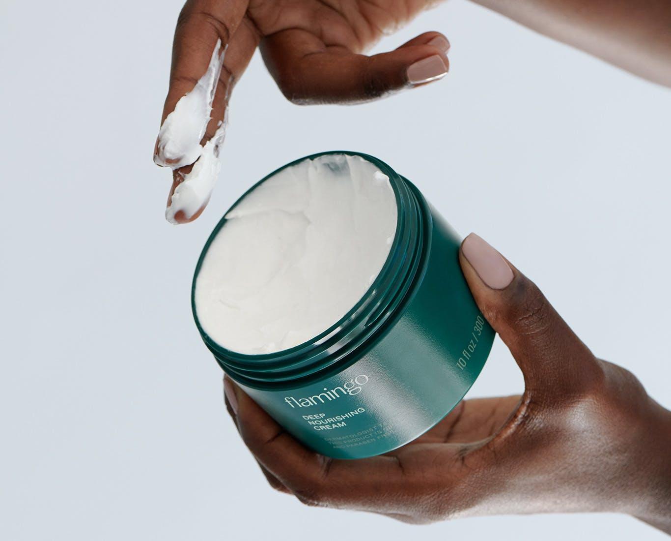 Woman applying Deep Nourishing Cream
