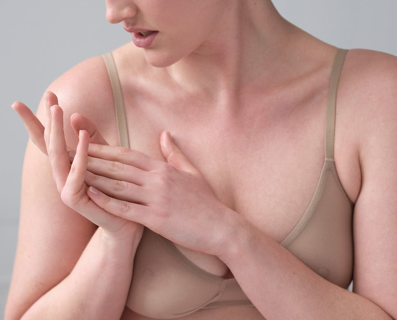 Woman putting lotion on hands